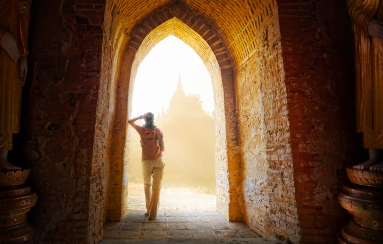 Young traveller enjoying a looking a temples at Bagan