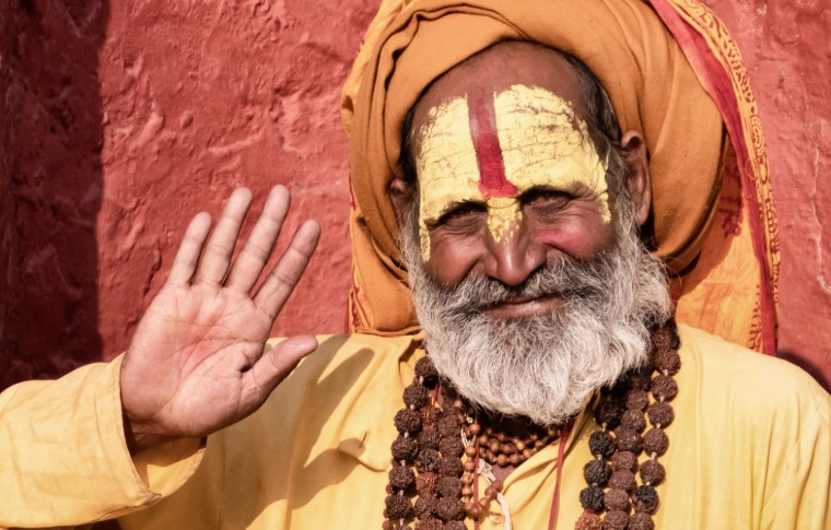 Sadhu man with traditional painted face in Pashupatinath Temple of Kathmandu