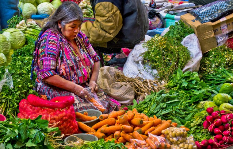woman selling fresh vegetables