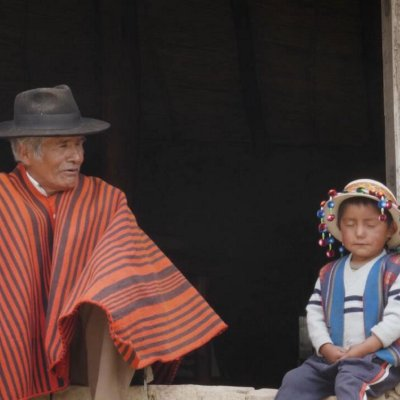 old man and child dressed in traditional clothing