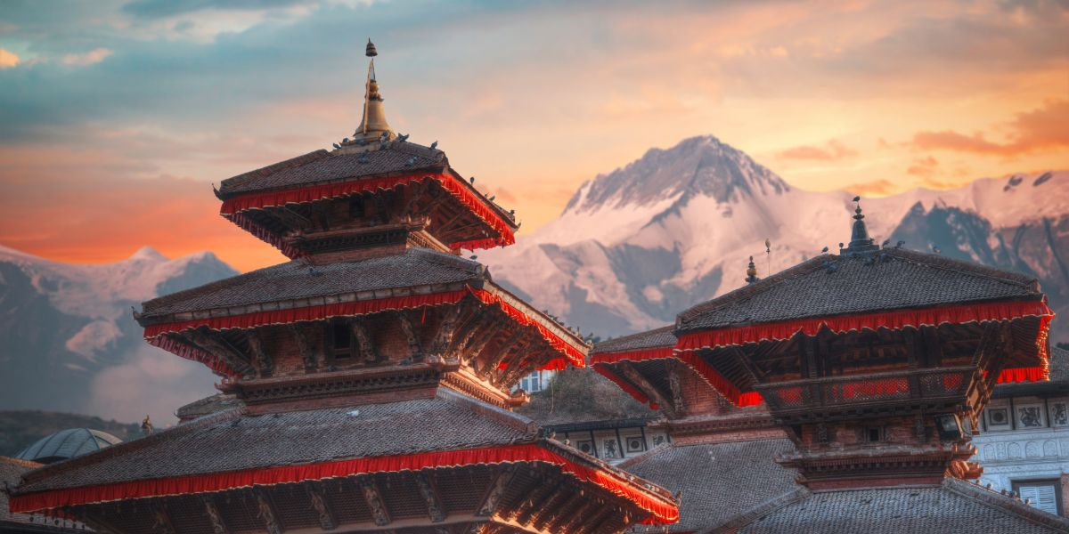 traditional red pagodas with mountain backdrop