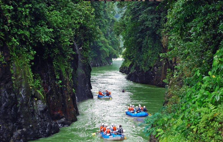 boats gliding down river